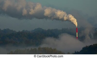 Air pollution in the nature, Industrial Smoke from the chimney on blue sky, France
