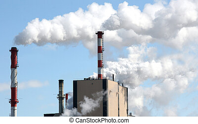 paper mill smoke stakes giving off pollution