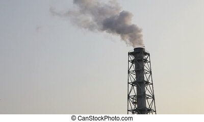 Air pollution smoke and steam discharged from Petrochemical...