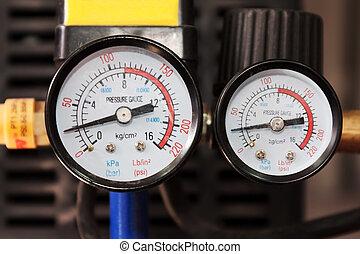 Air Pressure Manometer - Close view of a pair of air...