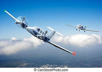Air race - Two small aircraft in pursuit, racing through the...
