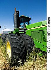 Air Seeder - A large air seeder system being pulled behind a...