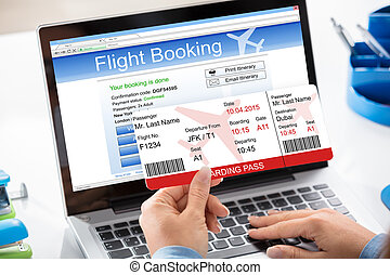 Air Ticket Flight Booking Concept - A Woman Booking Flight...