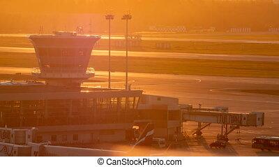 Air traffic control tower at sunset - Aerial shot of air...