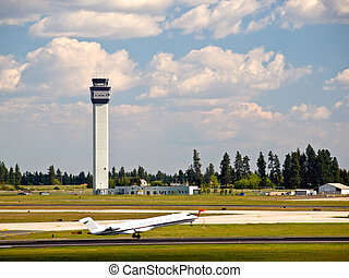 Air Traffic Control Tower of a Modern Airport with Aircraft...