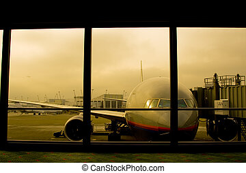 Air travel - A shot of a parked airplane in the airport