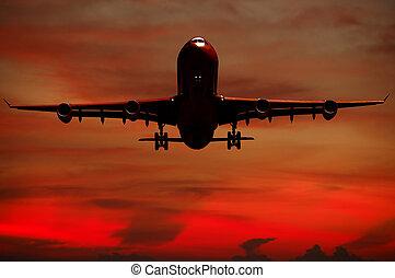 Air travel - Silhouett of plane and sunset