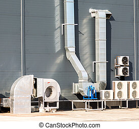 Air vent ducts of air conditioning and ventilation system on the roof of the large building