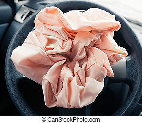 Airbag explodes on steering wheel, closeup view