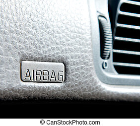 Airbag sign - An airbag sign in a car on the dash