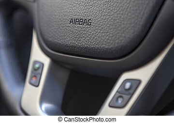 Airbag sign on the steering wheel of the vehicle, close-up