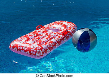 Airbed and Water Ball in Swimming Pool