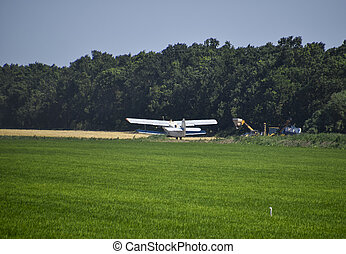 The spraying of fertilizers and pesticides on the field with the aircraft.