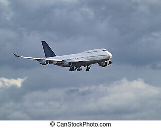 Aircraft among the clouds - Flying jumbo jet aircraft on the...