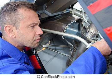aircraft assembler doing his job