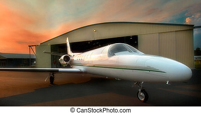Aircraft at dawn - A private jet aircraft awaits its early ...