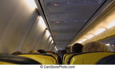 Aircraft cabin in flight - Inside passenger aircraft cabin ...