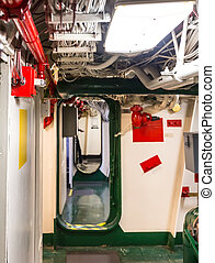 Aircraft carrier corridor with partitions, fire pipeline and...