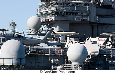 Aircraft Carrier - A navy helicopter on the deck of an...