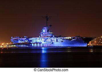 Aircraft Carrier USS Lexington illuminated at night, Corpus...