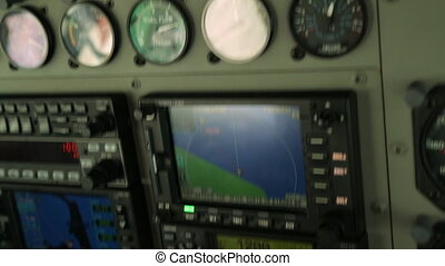 Extreme close-up still shot of an air-craft's cockpit navigation monitor displays during a flight to Lady Elliot Island, Great Barrier Reef.