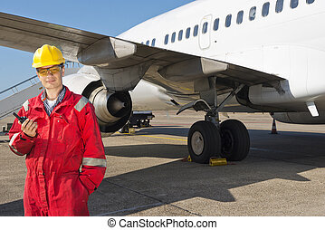 Aircraft Engineer - Aircraft engineer with CB radio standing...