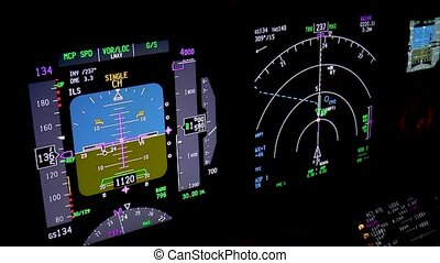 Aircraft flight instruments at night, actual aerial footage.