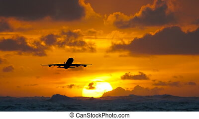 Aircraft flying over amazing tropical ocean at sunrise....