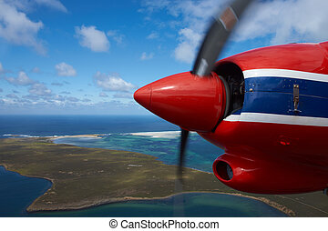 Aircraft flying over beautiful white sandy beaches and clear blue waters of the Falkland Islands in the South Atlantic