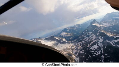 Aircraft flying over snowcovered mountain 4k - Private ...