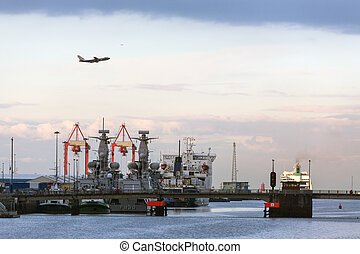 Aircraft flying over the port of Dublin - Ireland - A jet...