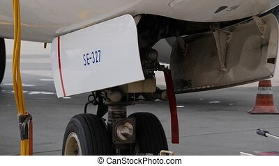 Aircraft ground handling. Fore undercarriage with pushback...