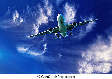 Aircraft in flight with cirrus cloud in blue sky. Australia.