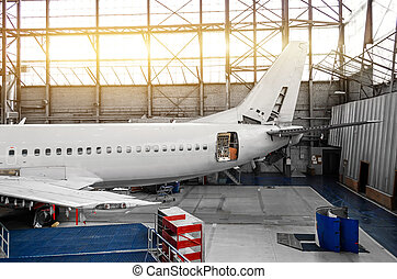 Aircraft in the hangar at the tail service.