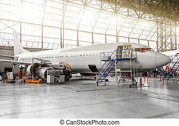 Aircraft in the hangar in the maintenance of plating, interior, engine repair.