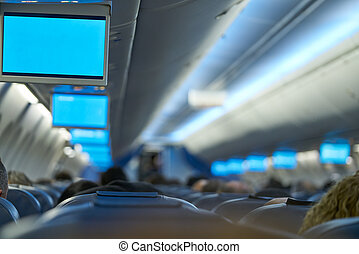 Aircraft indoor tv screens in a row