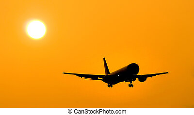 Aircraft landing at sunset