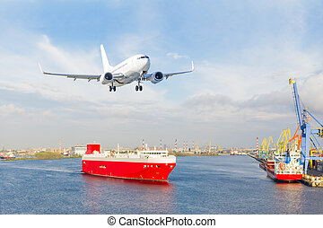 Aircraft landing approach over the cargo seaport.