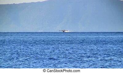 Aircraft landing at sea time lapse