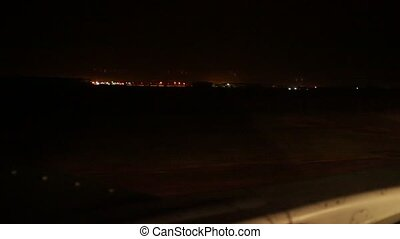 Aircraft landing in airport at night. Wings.
