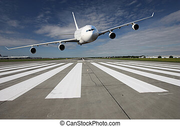 Aircraft low pass - White airplane overflights low over the...
