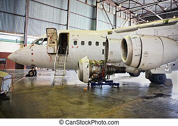 aircraft maintenance - dismantled plane engine under...