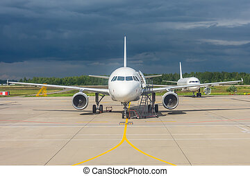 Aircraft maintenance parked in the open air airport, engine repair and mechanics check testing.