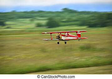 Aircraft model flying - Red and white radio controlled...
