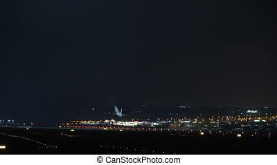 Aircraft night take-off. Airport lights in the dark
