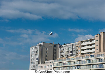 Aircraft over an apartment house in Flanders, Belgium