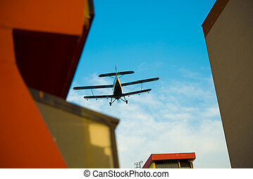 Aircraft over houses