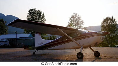 Private aircraft parked near hangar 4k