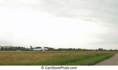 Aircraft plane is landing in an open grass field - A plane...