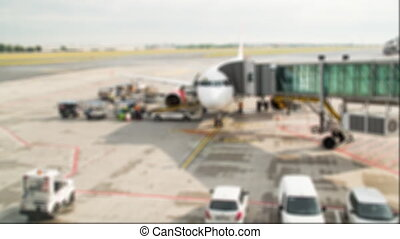 Aircraft preparation for flight. Time lapse blurred shot -...